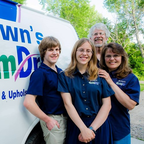 family of Brown's chem-dry carpet cleaning technicians in Hutchinson MN standing by their Brown's Chem-Dry van